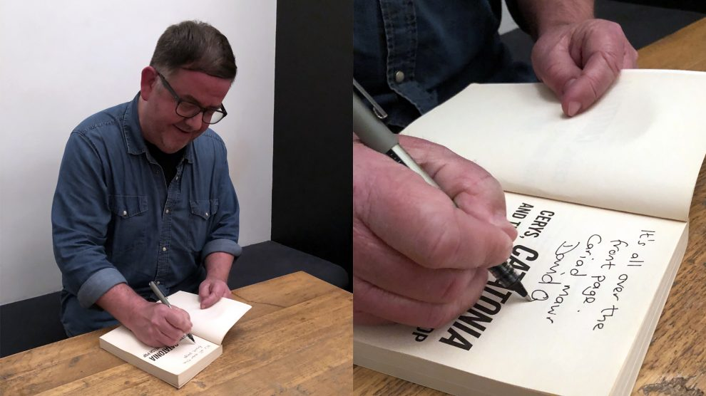 David Owens signing a copy of his book 'Cerys, Catatonia and the Rise of Welsh Pop'